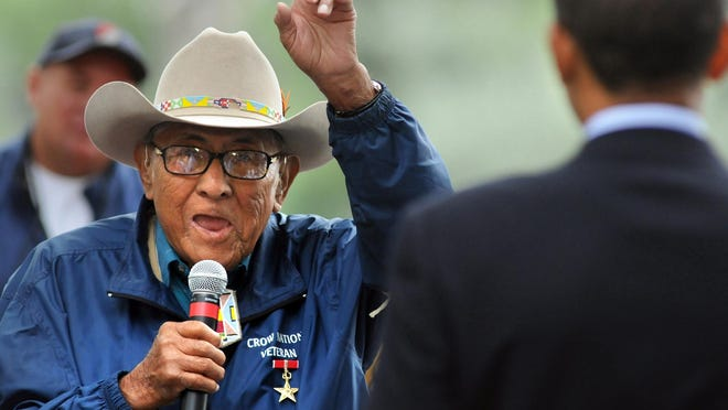 """Native American Crow historian Joe Medicine Crow tells then-presidential-candidate Barack Obama to """"take veterans to the top when you move into the White House,"""" during a visit to Billings in 2008. Medicine Crow died Sunday at age 102."""