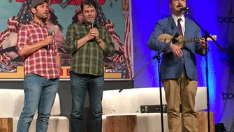 Nick Offerman, center, with Paul Rudd, left, and John Hodgman at BookCon on Saturday.