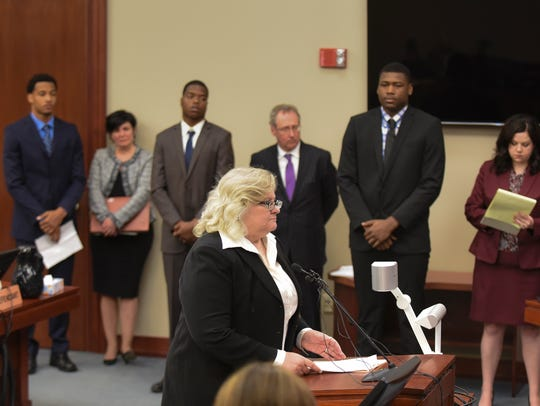 Attorney Karen Truszkowski reads a victim-impact statement