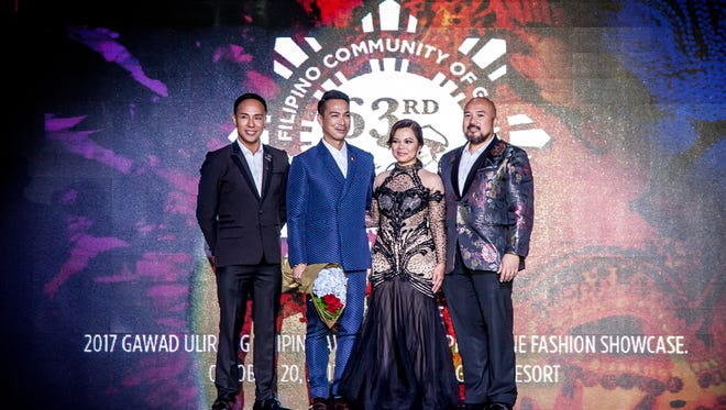 The Filipino Community of Guam featured a fashion showcase during its 63rd Anniversary Ball on Oct. 20, 2017 at the Dusit Thani Guam. The show included the collections of five famous international designers based in the Philippines. Pictured left to right are Nat Manilag, fashion designer; Francis Libiran, fashion designer; Hernalin Analista, FCG's first lady and executive producer for the fashion show; and Norman Analista, FCG president.