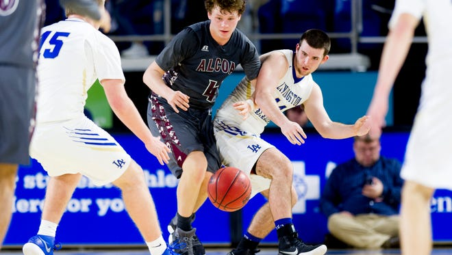 Alcoa's Nick Roberts (4) and Livingston's Wade Neely (14) eye a loose ball during a Division I Class AA quarterfinals game between Livingston and Alcoa at the TSSAA boys state basketball championships at the Murphy Center in Murfreesboro, Tennessee on Thursday, March 15, 2018.