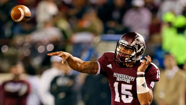 Oct 24, 2013; Starkville, MS, USA; Mississippi State Bulldogs quarterback Dak Prescott (15) passes the ball during the game against the Kentucky Wildcats at Davis Wade Stadium. Mandatory Credit: Spruce Derden-USA TODAY Sports