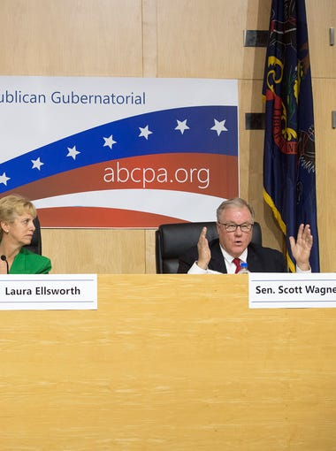 From the left, Paul Mango, Laura Ellsworth listen to Sen. Scott Wagner answer a question during a Republican Gubernatorial Forum at ABC PA's Free Enterprise Day in Harrisburg Monday April 16, 2018.