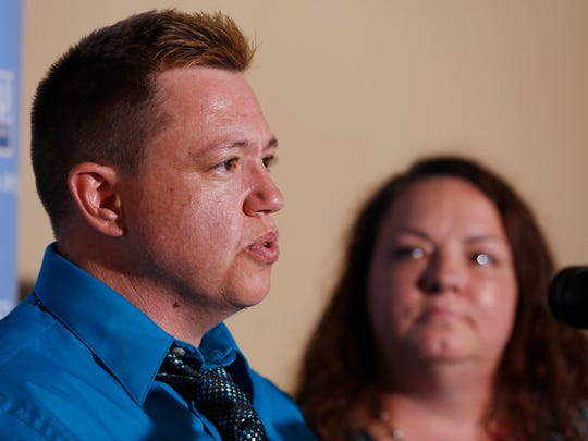 Jesse Vroegh gives a statement Thursday, July 21, 2016, during a news conference at the American Civil Liberties Union of Iowa offices in Des Moines. Vroegh filed a complaint with the Iowa Civil Rights Commission, alleging discrimination in the workplace for being a transgender male.