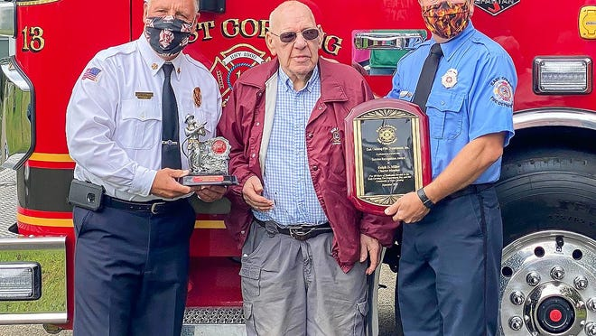 Ralph D. Miller, a charter member of the East Corning Fire Department, was presented Saturday with the 2020 Firefighter of the Year award.