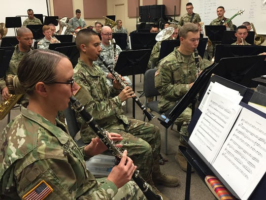 The 1st Armored Division Band recently rehearses for