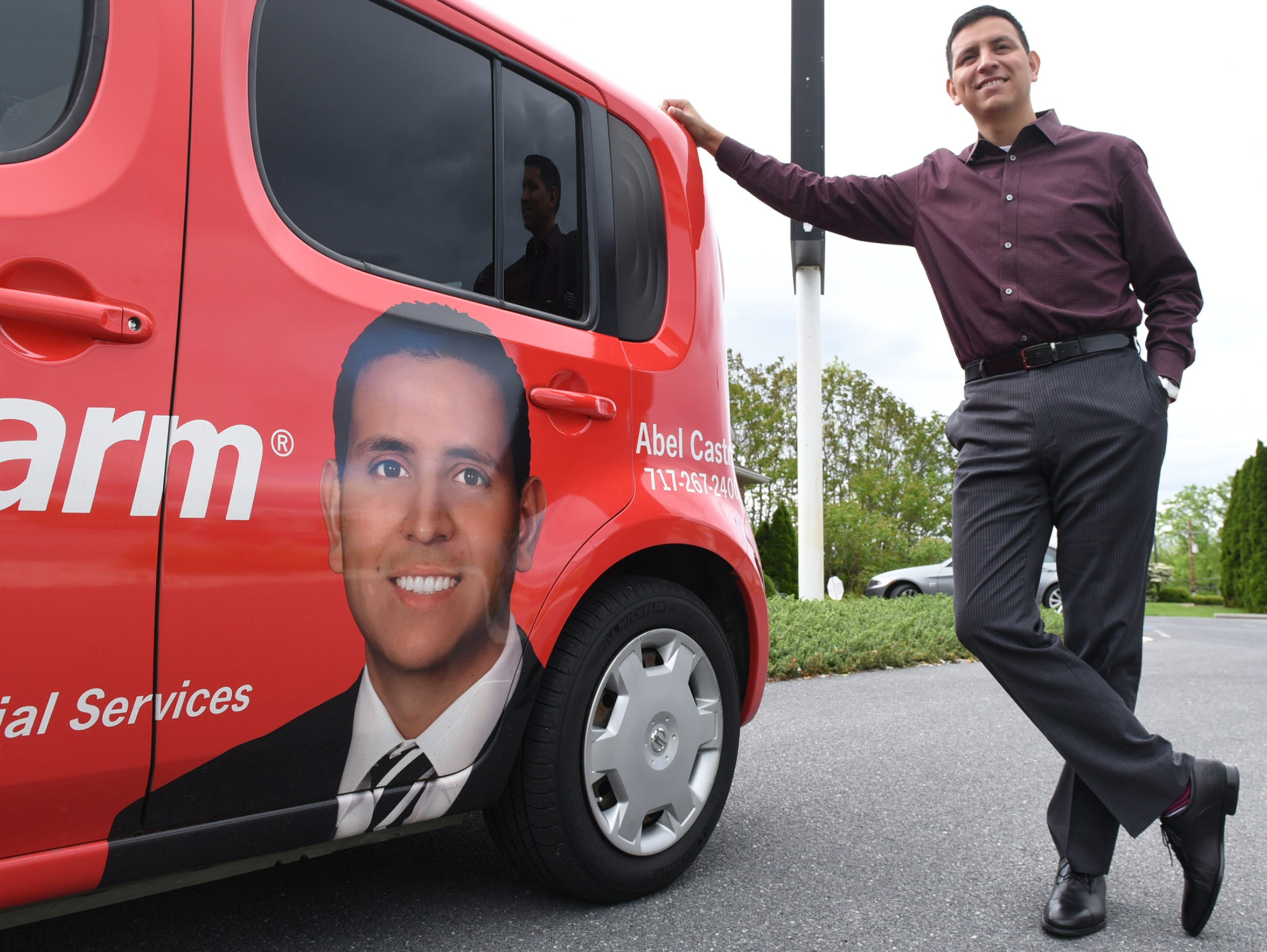 Abel Castro, a State Farm agent, is seen in front of
