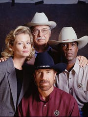 Assisting Chuck Norris (center foreground) as Texas Ranger Cordell Walker are  Sheree J. Wilson as the assistant district attorney Alex Cahill, Noble Willingham as former Texas Ranger C.D. Parker (top) and Clarence Gilyard as Ranger James Trivette (right).