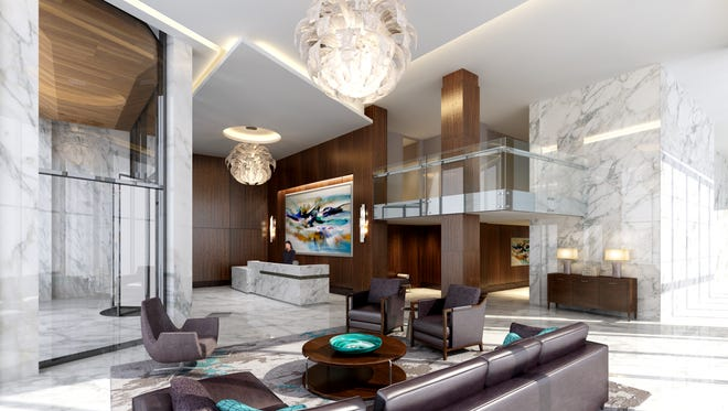 Representative of the luxury materials and lifestyle amenities designed into Avora, the impressive lobby provides residents with comfort and concierge service.