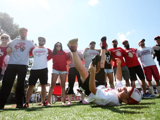 Nathan Fuentes, 10, leaps in front of UL baseball fans