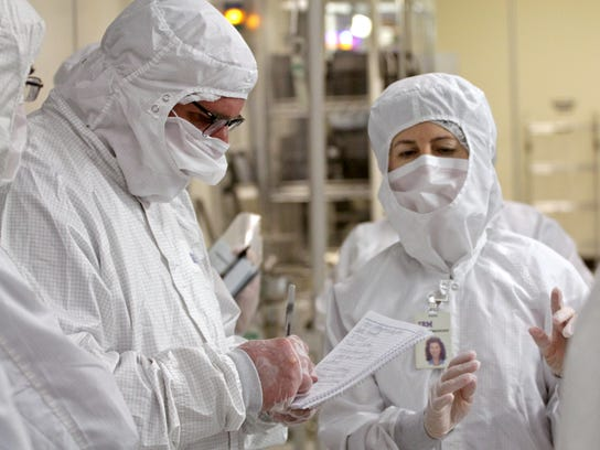 Workers in IBM Burlington's fab must wear protective