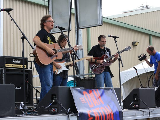 Dan Eaton performs with his band, The Dan Eaton Band, at the Fairport Music Festival in 2015.
