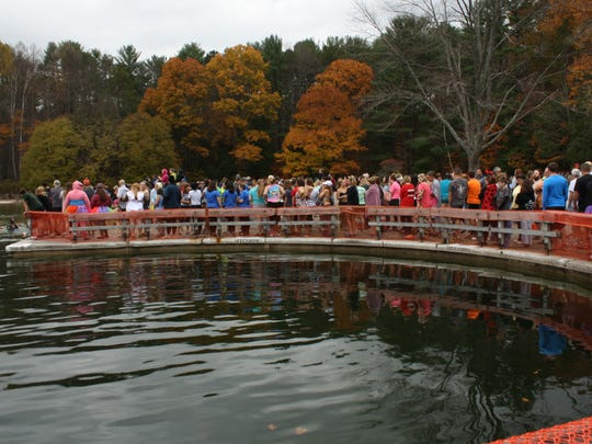 The line to jump into the 44-degree water during Saturday's
