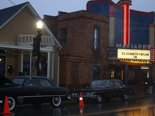 """Old cars parked in front of Bellevue's Marianne Theater Dec. 4 during """"The Blunderer"""" filming."""