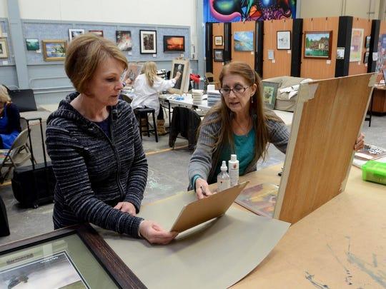 Pastel drawing instructor Kathy Fish, right, talks