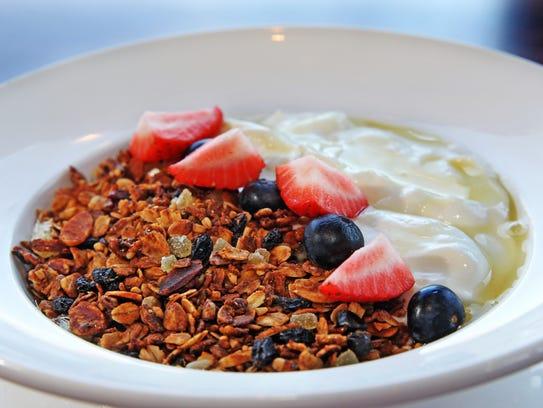 Ginger-almond granola with yogurt and honey, one of