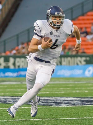 Nevada quarterback Ty Gangi runs with the football during a game earlier this season against Hawaii.