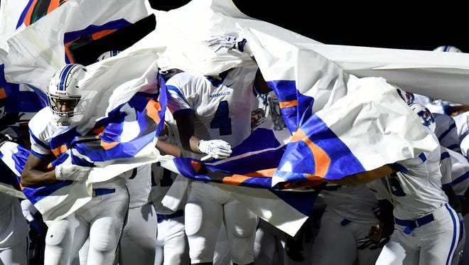 Marshall County wide receiver Jay Howard (4) runs onto the field with teammates before a high school football game against Stratford High School on Friday, Sept. 23, 2016, in Nashville, Tenn.