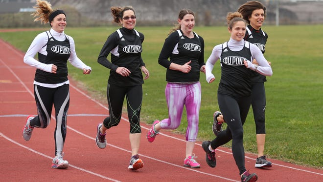 Trisha Byler, Henrietta, front right, runs with her DuPont colleagues during their lunch hour Monday, Dec. 7, 2015, at the Edison Tech High School track. Running with Byler are, from left, Laurine Zupp, Patti Thompson, Rachel Schrader and Phyllis Fleischman.