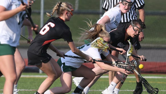 Yorktown and Mamaroneck battle for ball control during