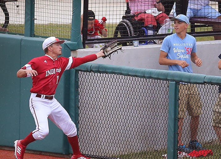 Indiana University's Will Nolden  make a catch in foul territory during the NCAA regional baseball game Sunday, June 1, 2014, evening at Bart Kaufman Field in Bloomington. IU lost to Stanford 10-7.