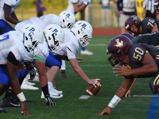 Port Chester waits to hike the ball during Friday's game against Arlington.