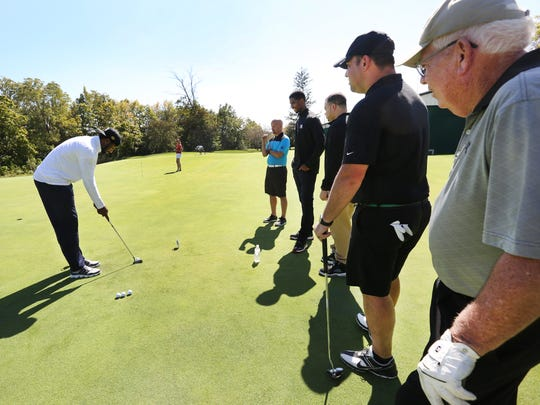 Indiana Pacer Solomon Hill (left) helped out with the putting contest at the annual Pacers Foundation Golf Outing on Thursday, September 24, 2015 at the Brickyard Crossing Golf Course in Indianapolis.