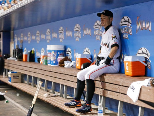 Miami Marlins' Ichiro Suzuki, of Japan, sits in the dugout during the first inning of a baseball game against the Los Angeles Dodgers, Friday, Sept. 9, 2016, in Miami. (AP Photo/Wilfredo Lee)