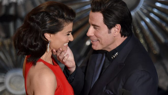 """John Travolta was criticized for touching of Idina Menzel's face and saying, """"You, you my darling, my beautiful ..."""" at the Oscars."""