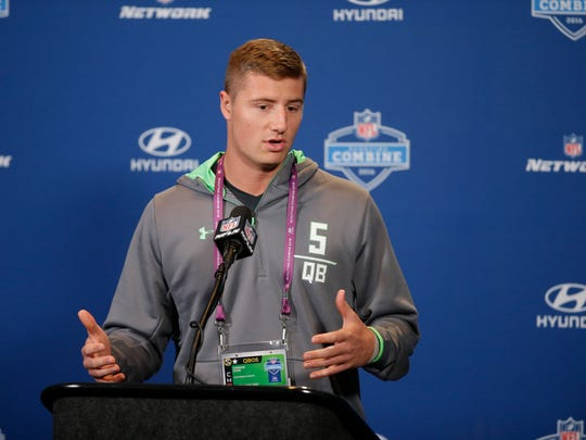 Connor Cook responds to a question earlier this week at the NFL combine.