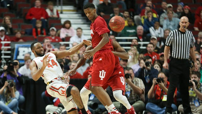 Dez Wells of Maryland (left) and IU's Troy Williams collide and the ball gets away. March 13, 2015