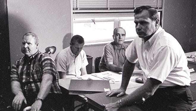 From left, Green Bay Packers assistant coaches Dave Hanner, Jerry Burns, Phil Bengtson and Bob Schnelker work in the draft room at Lambeau Field for the first combined NFL-AFL draft on March 14, 1967. It was the first time the Packers had been able to work from Green Bay during the draft. Picks were phoned to New York.
