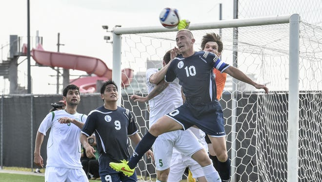 Guam forward Jason Cunliffe heads a corner kick at the FIFA World Cup Qualifier game against Turkmenistan at the Guam Football Association National Training Center in Harmon on June 11.