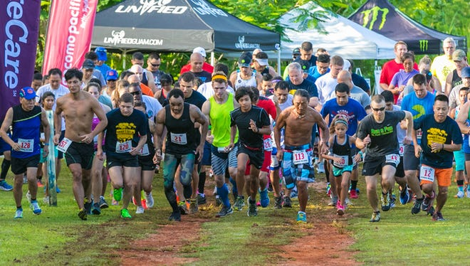 Competitors start the race for the Xterra Island Father's Day 5K run held at Two Lovers Point on June 21.