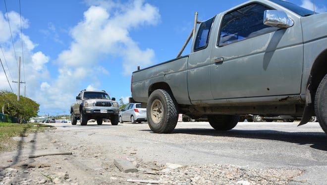 Vehicles travel down Hamburger Road in Harmon on June 25.