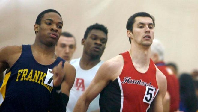Nile Uzzell of Franklin (left) and Vail Nazaryk of Hunterdon Central compete in the 400 during the Central Groups I and IV indoor track sectional championships on Friday at the Bennett Center in Toms River.