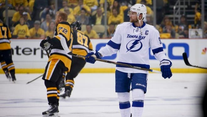 Tampa Bay Lightning's Steven Stamkos, right, skates beside Pittsburgh Penguins' Patric Hornqvist (72) before Game 7 of the NHL hockey Stanley Cup Eastern Conference finals, Thursday, May 26, 2016, in Pittsburgh.