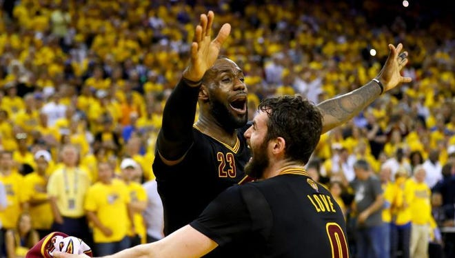 LeBron James and Kevin Love celebrate the Cleveland Cavaliers' 93-89 win over the Golden State Warriors in Game 7 of the 2016 NBA Finals on Sunday.