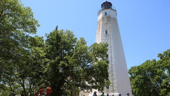 A Monmouth University archeology team works next to the Sandy Hook Lighthouse as part of a month-long dig in this file photo.