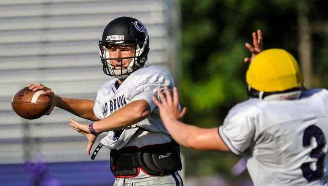 Old Bridge quarterback Artur Sitkowski throws a pass during practice.