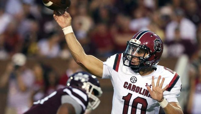 FILE - In this Sept. 10, 2016, file photo, South Carolina quarterback Perry Orth (10) throws the ball during the first half of their NCAA college football game against Mississippi State in Starkville, Miss., Saturday, Sept. 10, 2016. Senior Perry Orth has started the first two games. But freshman Brandon McIlwain may get the chance against fired-up East Carolina on Saturday. (AP Photo/Jim Lytle, File)