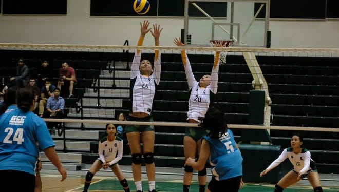 The University of Guam women's team competes against Guam Community College during the first season of the Guam Women's College Volleyball League.