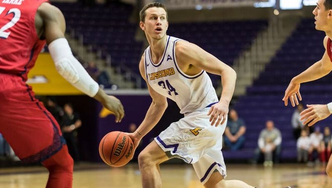 Lipscomb's Garrison Mathews looks for an open teammate in Saturday's game against NJIT at Allen Arena.