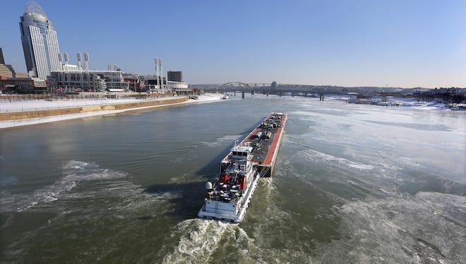 The newly named Ports of Cincinnati & Northern Kentucky has expanded from 26 miles to nearly 227 miles. Here, a barge breaks through the ice on the Ohio River in below-zero temperatures last week.