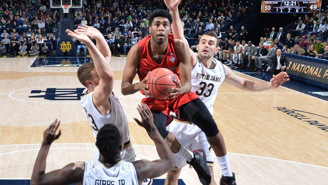 Dec 5, 2017; South Bend, IN, USA; Ball State Cardinals forward Tahjai Teague (25) goes up for a shot as Notre Dame Fighting Irish forward Martinas Geben (23) forward John Mooney (33) and guard T.J. Gibbs (10) defend in the second half at the Purcell Pavilion. Mandatory Credit: Matt Cashore-USA TODAY Sports