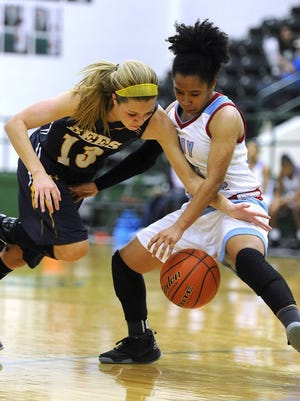 Thomas Metthe/Reporter-News   Hirschi's Jania Vinson (10) steals the ball away from Stephenville's Bayleigh Chaviers (13) during the fourth quarter of Hirchi's 57-46 loss in the Region I-4A bi-district playoff on Tuesday in Breckenridge.