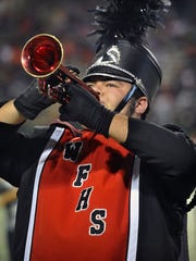 Torin Halsey/Times Record News Jordon Nieto plays a red trumpet in the Wichita Falls High School marching band Friday night at Memorial Stadium.