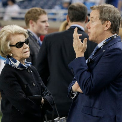 Detroit Lions owner Martha Ford, left, talks with her