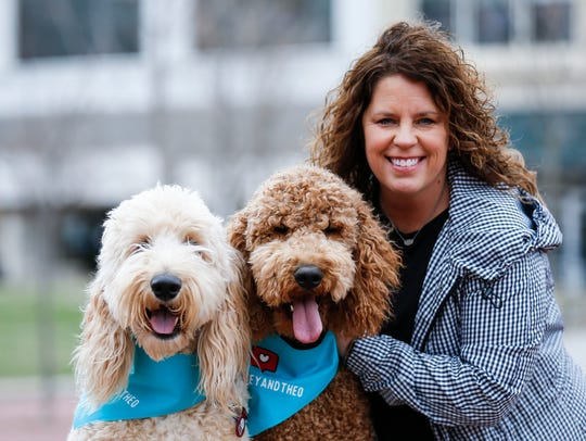 Stacey Heere and her goldendoodles Wrigley (left) and