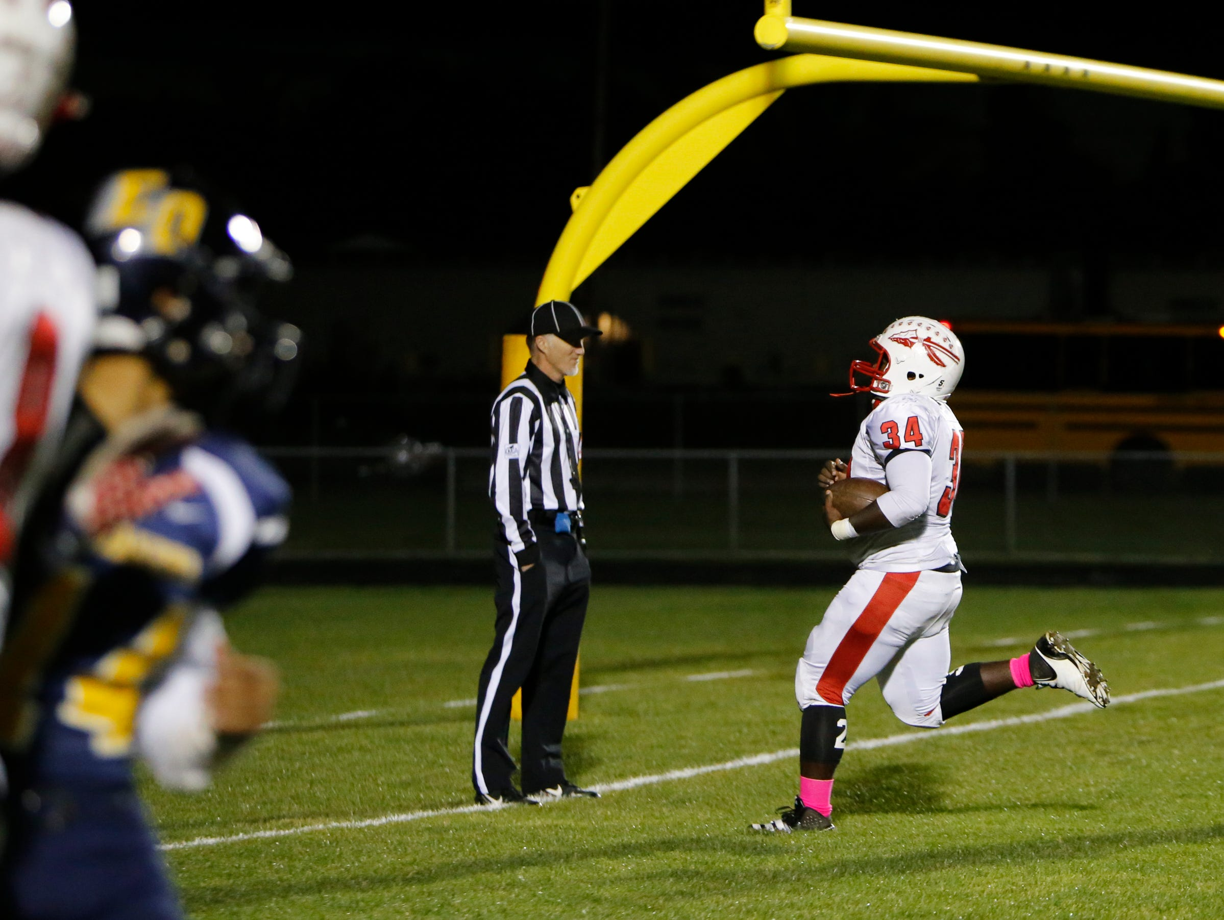Sexton's Byron Pierce scoots into the end zone for a touchdown Friday, October 21, 2016 against Lansing Eastern, giving the Big Reds a 12-0 first quarter lead at Sexton.